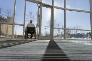 Michigan Social Security Lawyer   Man In Wheelchair Leaving Hospital